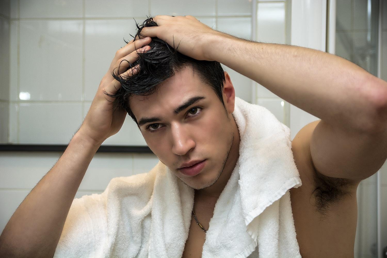 Man Finger drying his hair