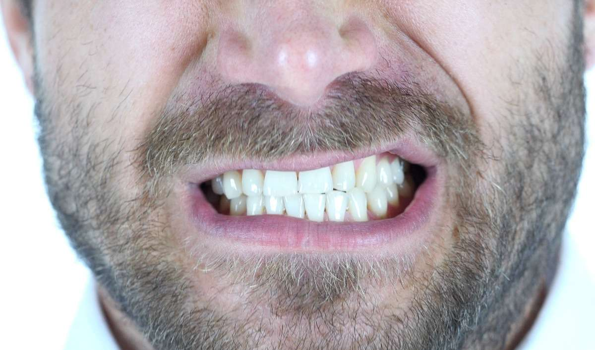 Why You Grind Your Teeth At Night—and How to Stop